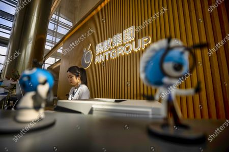 Stock Photo of A woman works at the reception desk of the Ant Group headquarters in Hangzhou, China, 27 September 2020 (issued 28 September 2020). Ant Group is the parent company of China's largest mobile payments business Alipay and leading provider of financial services technology. The Alipay mobile application serves over 1 billion annual active users, according to the company. Ant group is an affiliate company of the Alibaba Group founded by billionaire Jack Ma and it is preparing a simultaneous initial public offering (IPO) in Hong Kong and Shanghai.