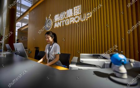 A woman works at the reception desk of the Ant Group headquarters in Hangzhou, China, 27 September 2020 (issued 28 September 2020). Ant Group is the parent company of China's largest mobile payments business Alipay and leading provider of financial services technology. The Alipay mobile application serves over 1 billion annual active users, according to the company. Ant group is an affiliate company of the Alibaba Group founded by billionaire Jack Ma and it is preparing a simultaneous initial public offering (IPO) in Hong Kong and Shanghai.