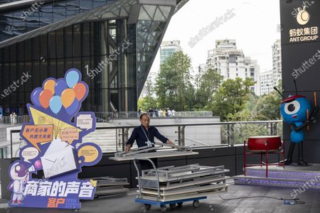 A man works in front of the Ant Group headquarters in Hangzhou, China, 27 September 2020 (issued 28 September 2020). Ant Group is the parent company of China's largest mobile payments business Alipay and leading provider of financial services technology. The Alipay mobile application serves over 1 billion annual active users, according to the company. Ant group is an affiliate company of the Alibaba Group founded by billionaire Jack Ma and it is preparing a simultaneous initial public offering (IPO) in Hong Kong and Shanghai.