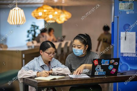 People work in a office within the Ant Group headquarters in Hangzhou, China, 27 September 2020 (issued 28 September 2020). Ant Group is the parent company of China's largest mobile payments business Alipay and leading provider of financial services technology. The Alipay mobile application serves over 1 billion annual active users, according to the company. Ant group is an affiliate company of the Alibaba Group founded by billionaire Jack Ma and it is preparing a simultaneous initial public offering (IPO) in Hong Kong and Shanghai.