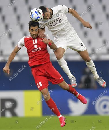Boualem Khoukhi (R) of Al Sadd SC vies with Vahid Amiri of Persepolis FC during the AFC Asian Champions League round of 16 football match between Persepolis FC of Iran and Al Sadd SC of Qatar at Al Education City Stadium in Doha, Capital of Qatar, Sept. 27, 2020.