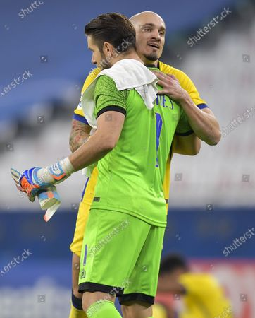 Al Nassr's goalkeeper Brad Jones (L) and Maicon celebrate their victory after the AFC Asian Champions League round of 16 football match between Taawoun FC and Al Nassr of Saudi Arabia at Education City Stadium in Doha, Qatar, Sept. 27, 2020.