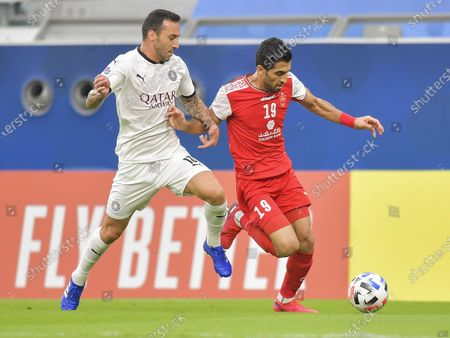 Guilherme (L) of Al Sadd SC vies for the ball with Vahid Amiri of Persepolis FC during the AFC Asian Champions League round of 16 football match between Persepolis FC of Iran and Al Sadd SC of Qatar at Al Education City Stadium in Doha, Capital of Qatar, Sept. 27, 2020.