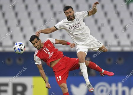 Boualem Khoukhi (R) of Al Sadd SC vies for a header with Vahid Amiri of Persepolis FC during the AFC Asian Champions League round of 16 football match between Persepolis FC of Iran and Al Sadd SC of Qatar at Al Education City Stadium in Doha, Capital of Qatar, Sept. 27, 2020.
