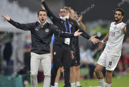 Stock Picture of Al Sadd SC head coach Xavi Hernandez (1st, L) reacts during the AFC Asian Champions League round of 16 football match between Persepolis FC of Iran and Al Sadd SC of Qatar at Al Education City Stadium in Doha, Capital of Qatar, Sept. 27, 2020.
