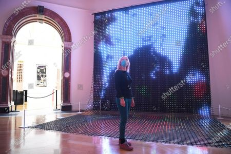 A masked staff member poses with 'I'd walk with you but not with her' by Jane and Louise Wilson during a photocall for the 252nd Summer Exhibition at the Royal Academy of Arts in London, Britain, 28 September 2020. Due to the coronavirus pandemic for the first time in the history, the Summer Exhibition will take place in the autumn. Over 1000 works in a range of media, by emerging and established artists, feature in the exhibition. Summer Exhibition at the Royal Academy of Arts, London, runs from 06 October 2020 to 03 January 2021.