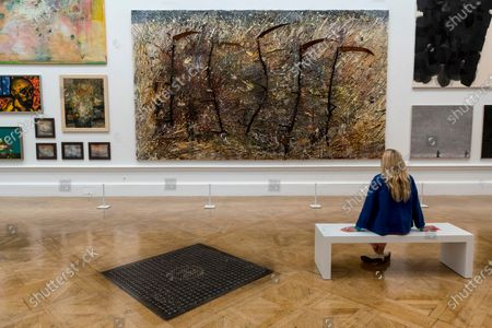 "A staff member views with ""Vier Plus Eins"" by Anselm Kiefer (Hon RA). Preview of the Summer Exhibition at the Royal Academy of Arts in Piccadilly which, due to the Covid-19 lockdown, is taking place for the first time in the autumn. Over 1000 works in a range of media by Royal Academicians, established and emerging artists, feature in the exhibition which runs from 6 October 2020 - 3 January 2021."