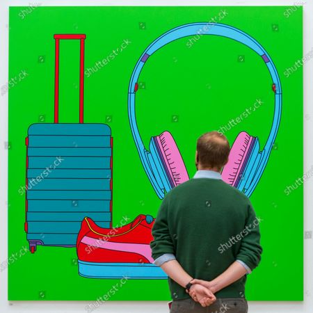 """A staff member poses with """"Untitled (With Suitcase)"""" by Sir Michael-Craig-Martin (RA). Preview of the Summer Exhibition at the Royal Academy of Arts in Piccadilly which, due to the Covid-19 lockdown, is taking place for the first time in the autumn. Over 1000 works in a range of media by Royal Academicians, established and emerging artists, feature in the exhibition which runs from 6 October 2020 - 3 January 2021."""
