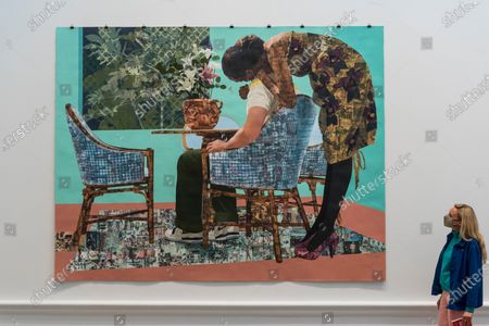 """Stock Picture of A staff member poses with """"Blend In - Stand Out"""" by Njideka Akunyili Crosby. Preview of the Summer Exhibition at the Royal Academy of Arts in Piccadilly which, due to the Covid-19 lockdown, is taking place for the first time in the autumn. Over 1000 works in a range of media by Royal Academicians, established and emerging artists, feature in the exhibition which runs from 6 October 2020 - 3 January 2021."""
