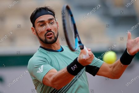 Stock Picture of Italy's Fabio Fognini plays a shot against Kazakhstan's Mikhail Kukushkin in the first round match of the French Open tennis tournament at the Roland Garros stadium in Paris, France