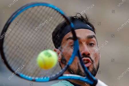 Italy's Fabio Fognini plays a shot against Kazakhstan's Mikhail Kukushkin in the first round match of the French Open tennis tournament at the Roland Garros stadium in Paris, France