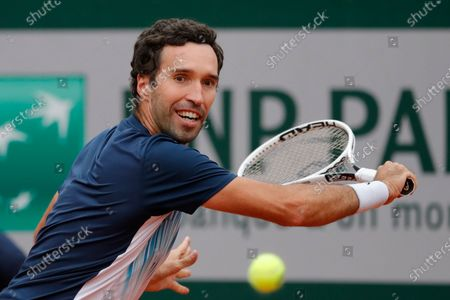 Kazakhstan's Mikhail Kukushkin plays a shot against Italy's Fabio Fognini in the first round match of the French Open tennis tournament at the Roland Garros stadium in Paris, France