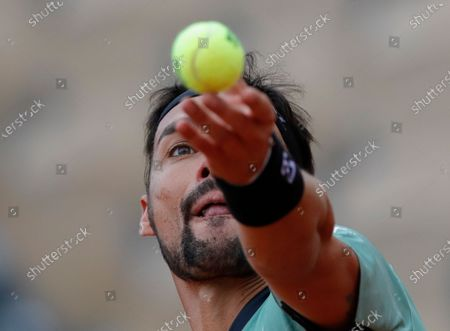Stock Photo of Italy's Fabio Fognini serves against Kazakhstan's Mikhail Kukushkin in the first round match of the French Open tennis tournament at the Roland Garros stadium in Paris, France