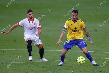 Sergi Gomez of Sevilla FC and Alvaro Negredo of Cadiz CF