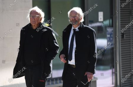 Journalist John Pilger (L) and John Shipton (R), father of Wikileaks founder Julian Assange, attend his trial at the Old Bailey Courthouse in London, Britain, 28 September 2020. Assange is fighting being extradited to the US on charges relating to leaks of classified documents allegedly exposing war crimes and abuse.