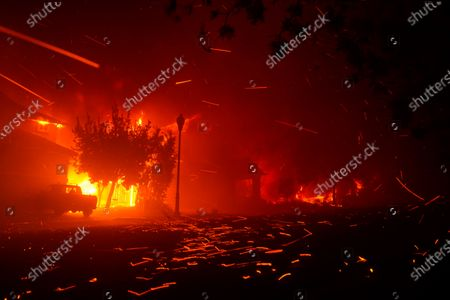 The Shady Fire impacts homes in the Skyhawk community, along Mountain Hawk Drive as firefighters battle the Shady Fire on Monday, Sept. 28, 2020 in Santa Rosa, CA. (Kent Nishimura / Los Angeles Times)