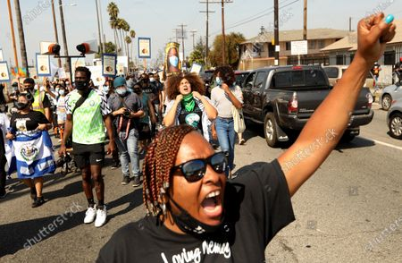 LOS ANGELES, CA - SEPTEMBER 23, 2020 - Sequarier McCoy, foreground, aunt of Dijon Kizzee, joins close to a hundred people, led by the Coalition for Community Control Over the Police, who march down Vermont Avenue to the South L.A. Sheriff's Station protesting the fatal shootings of Dijon Kizzee, Anthony Guardado and Anthony Weber in Los Angeles on September 27, 2020. The protesters were also joined by Guardado's father Cristobal Guardado. (Genaro Molina / Los Angeles Times)