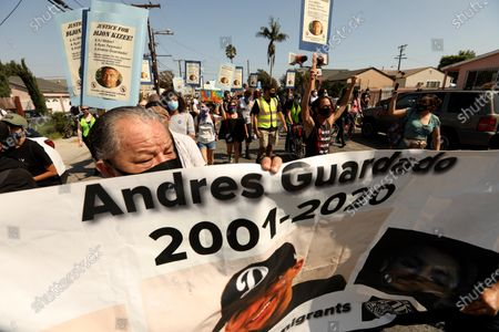 LOS ANGELES, CA - SEPTEMBER 23, 2020 - Cristobal Guardado, foreground, father of Anthony Guardado, foreground, joins close to a hundred people, led by the Coalition for Community Control Over the Police, who march to the South L.A. Sheriff's Station protesting the fatal shootings of Dijon Kizzee, Anthony Guardado and Anthony Weber in Los Angeles on September 27, 2020. The protesters were also joined by Sequarier McCoy, the aunt of Dijon Kizzee. (Genaro Molina / Los Angeles Times)