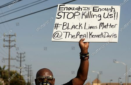 LOS ANGELES, CA - SEPTEMBER 23, 2020 - Kenneth Davis joins close to a hundred people, led by the Coalition for Community Control Over the Police, and demonstrate near the South L.A. Sheriff's Station protesting the fatal shootings of Dijon Kizzee, Anthony Guardado and Anthony Weber on W. Imperial Highway in Los Angeles on September 27, 2020. The protesters were joined by Kizzee's aunt Sequarier McCoy and Guardado's father Cristobal Guardado. (Genaro Molina / Los Angeles Times)