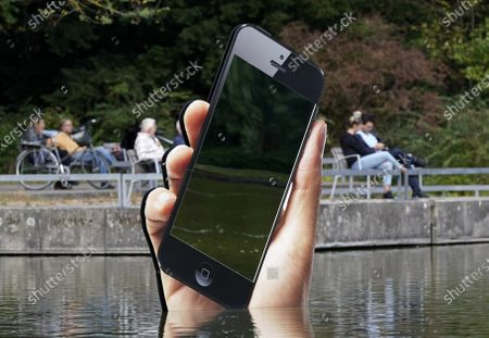 Stock Photo of The installation 'Obsolete Presence' by Aram Bartholl stands in a pond in the castle garden during the media art festival 'Seasons of Media Arts' in Karlsruhe, Germany, 28 September 2020. Various media-based artistic projects are on display throughout the city of Karlsruhe as part of the festival.