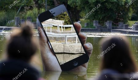 The installation 'Obsolete Presence' by Aram Bartholl stands in a pond in the castle garden during the media art festival 'Seasons of Media Arts' in Karlsruhe, Germany, 28 September 2020. Various media-based artistic projects are on display throughout the city of Karlsruhe as part of the festival.