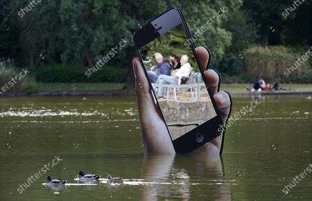 Stock Picture of The installation 'Obsolete Presence' by Aram Bartholl stands in a pond in the castle garden during the media art festival 'Seasons of Media Arts' in Karlsruhe, Germany, 28 September 2020. Various media-based artistic projects are on display throughout the city of Karlsruhe as part of the festival.