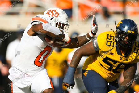 Oklahoma State running back LD Brown (0) runs the ball during an NCAA college football game, in Stillwater, Okla