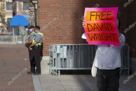 A protester holds a sign that reads 'Free David Wright' as he joins the group Mass Action Against Police Brutality, in a protest outside of the Joseph Moakley Federal Courthouse, calling for the release of David Wright and the reopening the case of Usaamah Rahim, in Boston, Massachusetts, USA, 28 September 2020. The group calls for investigation into the police shooting death of Rahim in 2015, and the dropping of the charges against Wright, the nephew of Rahim, due to the lack of credible evidence.