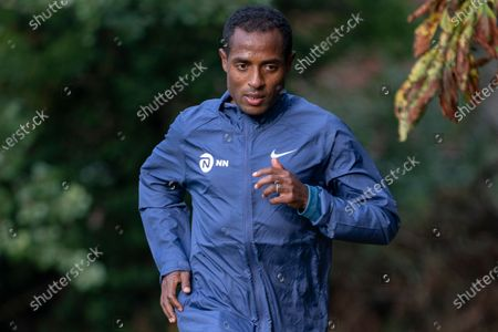 CAPTION CORRECTION: FREE FOR EDITORIAL USE ON BEHALF OF LONDON MARATHON. Kenenisa Bekele (ETH) trains alongside his coach Peter Eemers within the grounds of the official hotel [location not disclosed] and biosecure bubble ahead of the historic elite-only 2020 Virgin Money London Marathon on Sunday 4 October. The 40th Race will take place on a closed-loop circuit around St James's Park in central London. Wednesday 30th September 2020. Photo: Bob Martin for London Marathon Events  For further information: media@londonmarathonevents.co.uk