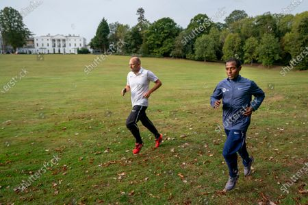 CAPTION CORRECTION: FREE FOR EDITORIAL USE ON BEHALF OF LONDON MARATHON. Kenenisa Bekele (ETH) trains alongside a member of coaching staff Peter Eemers within the grounds of the official hotel [location not disclosed] and biosecure bubble ahead of the historic elite-only 2020 Virgin Money London Marathon on Sunday 4 October. The 40th Race will take place on a closed-loop circuit around St James's Park in central London. Wednesday 30th September 2020. Photo: Bob Martin for London Marathon Events  For further information: media@londonmarathonevents.co.uk