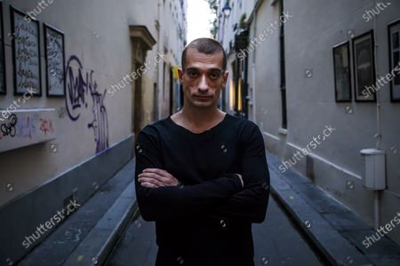 Stock Photo of Russian political performance artist Pyotr Pavlensky poses for photographs during an event to promote his new book 'Theoremes' (theorems) in Paris, France, 28 September 2020. Pavlenski claimed to have released a compromising video online that ended the French ruling party candidate Benjamin Griveaux's hopes of becoming Mayor of Paris