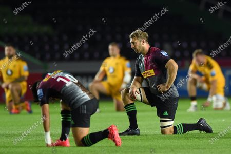 Chris Robshaw of Harlequins takes a knee prior to the match