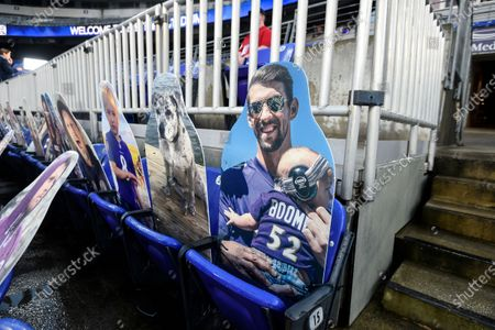 Cutout of Olympic swimmer Michael Phelps is seen in the stands before an NFL football game between the Baltimore Ravens and the Kansas City Chiefs, in Baltimore