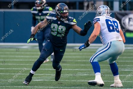 Seattle Seahawks defensive end Damontre Moore, left, fights off the block of the Dallas Cowboys offensive lineman Brandon Knight during the second half of an NFL football game, in Seattle. The Seahawks won 38-31