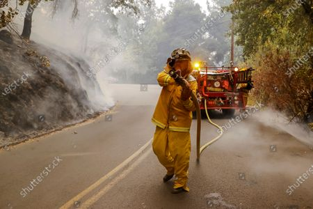 Stock Picture of Mark Jones of the Eagle Field Fire Department uses a restored 1942 US Army fire truck to fight the Glass Fire burning near the town of St. Helena in Napa County, California, USA, 28 September 2020. Northern California is under extreme fire alert.