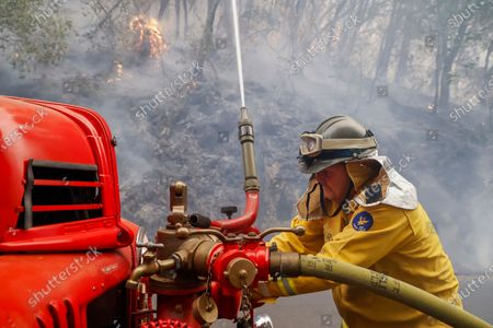 Mark Jones of the Eagle Field Fire Department uses a restored 1942 US Army fire truck to fight the Glass Fire burning near the town of St. Helena in Napa County, California, USA, 28 September 2020. Northern California is under extreme fire alert.