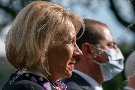 United States Secretary of Education Betsy DeVos listens as US President Donald J. Trump gives an update on the Nation's Coronavirus Testing Strategy in the Rose Garden of the White House September 28, 2020 in Washington DC.