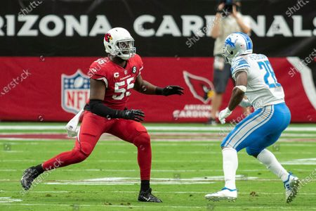 Arizona Cardinals linebacker Chandler Jones (55) in action against Detroit Lions running back Adrian Peterson (28) during an NFL football game, in Glendale, Ariz. The Lions won 26-23
