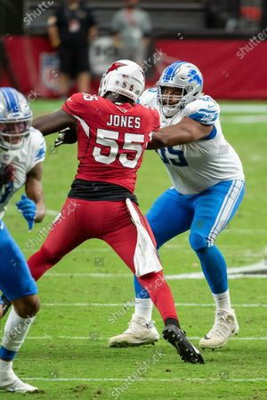 Detroit Lions offensive tackle Tyrell Crosby (65) blocks Arizona Cardinals linebacker Chandler Jones (55) during an NFL football game, in Glendale, Ariz. The Lions won 26-23