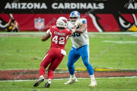 Detroit Lions offensive tackle Tyrell Crosby (65) blocks Arizona Cardinals outside linebacker Devon Kennard (42) during an NFL football game, in Glendale, Ariz. The Lions won 26-23