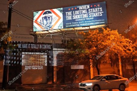 Projection is shown on a building, in Cleveland, by Robin Bell, an American multimedia visual artist, with the words President Donald Trump used when he talked about the coronavirus on Jan. 22, 2020. The billboard art was created by Shepard Fairey. The first presidential debate between Republican candidate President Donald Trump and Democratic candidate former Vice President Joe Biden will be held Tuesday in Cleveland
