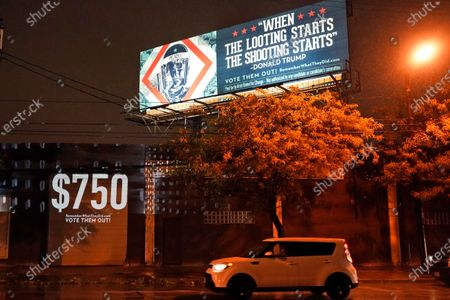 Projection is shown on a building, in Cleveland, by Robin Bell, an American multimedia visual artist, with the words President Donald Trump used when he talked about the coronavirus on Jan. 22, 2020. Trump paid $750 in U.S income taxes in 2016 and 2017. The billboard art was created by Shepard Fairey. The first presidential debate between Republican candidate President Donald Trump and Democratic candidate former Vice President Joe Biden will be held Tuesday in Cleveland