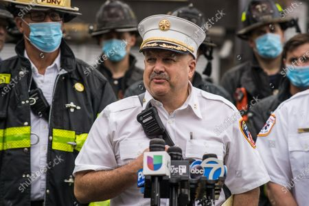 Stock Image of FDNY Deputy Chief Joseph Ferrante held a press conference and explains details about the rescue. Fire fighters rescued three young children from a burning building in the Williamsburg section of the Bronx. The fire was quickly extingushed which is when fire fighters found the children to be home alone.They were taken to a local hospital and are in critical but stable condition.