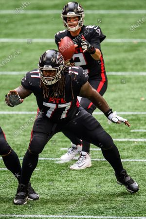 Atlanta Falcons offensive guard James Carpenter (77) works against the Chicago Bears during the first half of an NFL football game, in Atlanta. The Chicago Bears won 30-26