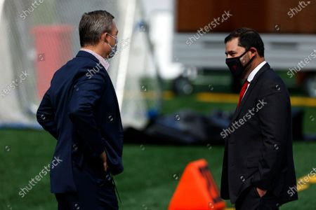 San Francisco 49ers owner Jed York talks with general manager John Lynch prior to an NFL football game against the New York Giants, in East Rutherford, N.J