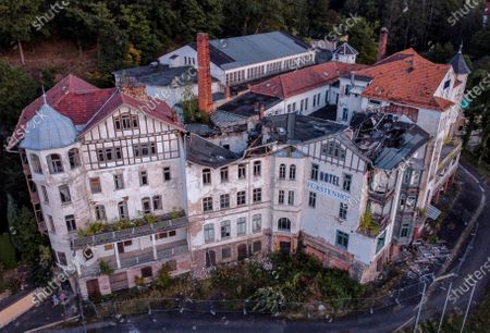 """The abandoned and wrecked """"Fuerstenhof"""" hotel is seen in Eisenach, eastern Germany, . The once famous hotel where Adolf Hitler delivered a speech in 1932 was closed in 1996. Thirty years after Germany was reunited on Oct. 3, 1990, many once-decrepit city centers in the formerly communist east have been painstakingly restored and new factories have sprung up. But many companies and facilities didn't survive the abrupt transition to capitalism inefficient companies found themselves struggling to compete in a market economy, while demand for eastern products slumped and outdated facilities were shut down"""