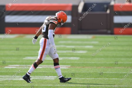 Cleveland Browns linebacker Tae Davis walks off the field with an elbow injury during an NFL football game against the Washington Football Team, in Cleveland. The Browns won 34-20
