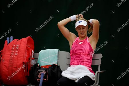 Alison Riske of the U.S. ties her hair in the first round match of the French Open tennis tournament against Germany's Julia Georges at the Roland Garros stadium in Paris, France