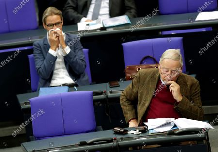 Alice Weidel, left, and Alexander Gauland, right, faction leader of the Alternative for Germany party, attend a budget debate as part of a meeting of the German federal parliament, Bundestag, at the Reichstag building in Berlin, Germany