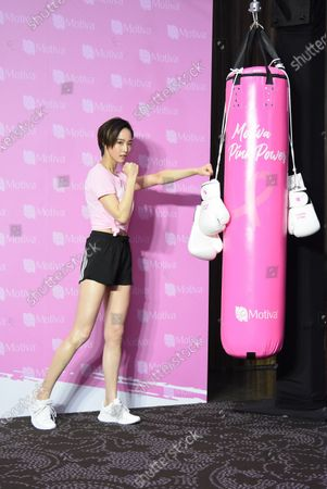 Janine Chang attends a breast cancer prevention charity event as the ambassador by wearing a sports suit.